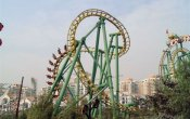 photos of Snow Mountain Flying Dragon roller coaster in Happy Valley Shenzhen theme park